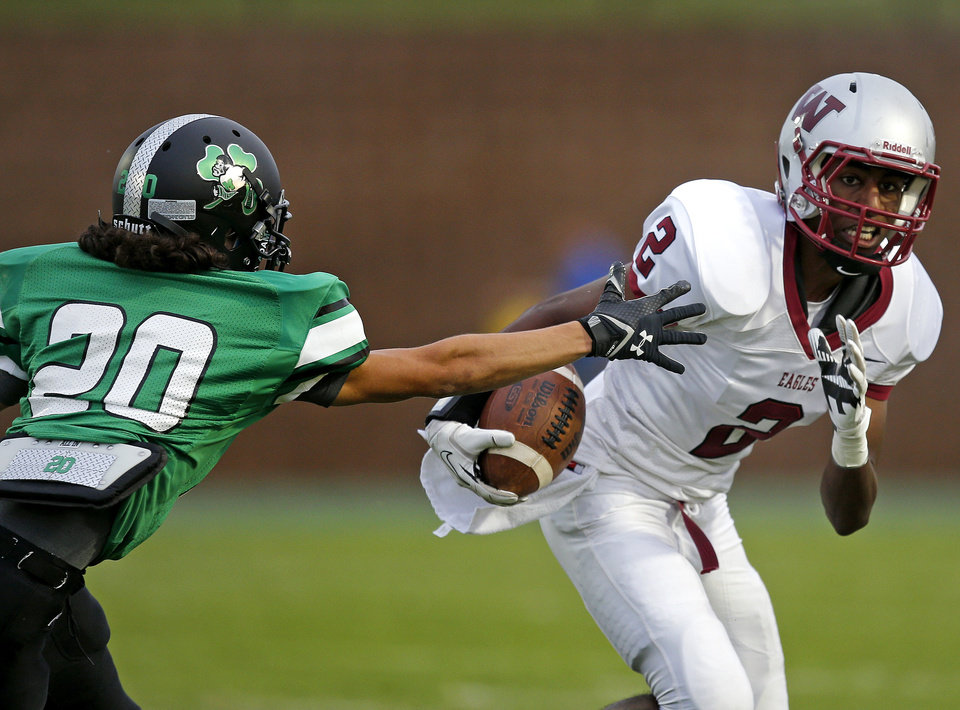 Weatherford's Tae Moore goes past Braden Roy of Bishop McGuinness during their high school football game in Oklahoma City, Friday, Sept. 20, 2013. Photo by Bryan Terry, The Oklahoman