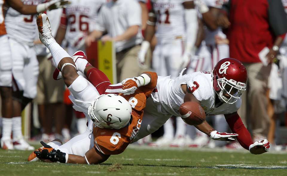 Photo - UT's Quandre Diggs (6) breaks up a pass intended for OU's Sterling Shepard (3) during the Red River Rivalry college football game between the University of Oklahoma Sooners and the University of Texas Longhorns at the Cotton Bowl Stadium in Dallas, Saturday, Oct. 12, 2013. Texas won 36-20. Photo by Bryan Terry, The Oklahoman
