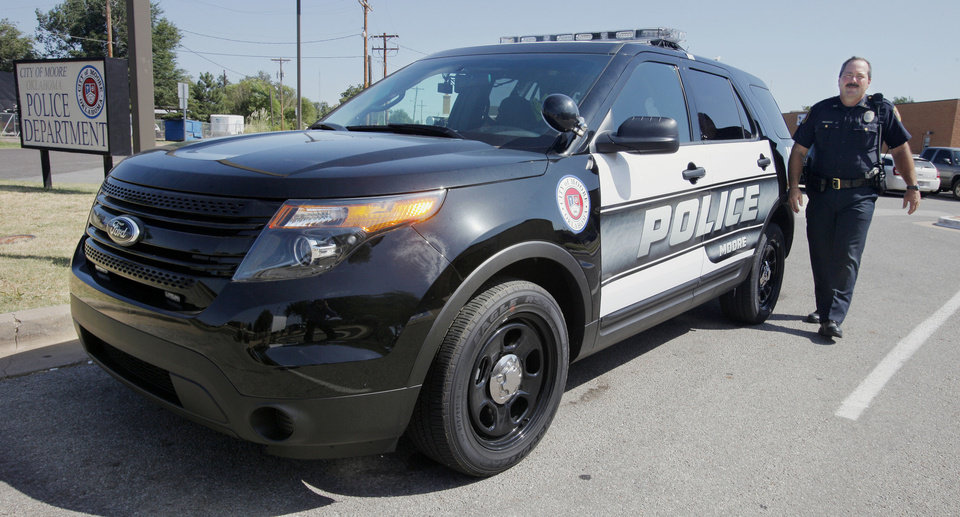 Photo - Sgt. Scott Stutzman walks toward his new Ford Police Interceptor utility vehicle at the Moore Police Department on Tuesday. PHOTOS BY PAUL B. SOUTHERLAND, THE OKLAHOMAN