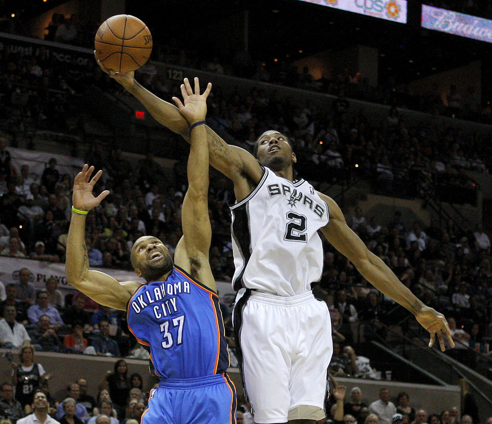 San Antonio\'s Kawhi Leonard (2) grabs the ball over Oklahoma City\'s Derek Fisher (37) during Game 2 of the Western Conference Finals between the Oklahoma City Thunder and the San Antonio Spurs in the NBA playoffs at the AT&T Center in San Antonio, Texas, Tuesday, May 29, 2012. Photo by Bryan Terry, The Oklahoman