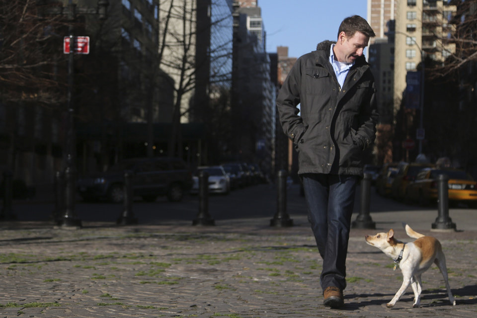 "Photo - In this Saturday, Jan. 19, 2013 photo, Michael Wright and his dog Toby (formerly called Fumble) pose for a portrait in New York.  ""Puppy Bowl,"" an annual two-hour TV special that mimics a football game with canine players, made its debut eight years ago on The Animal Planet."