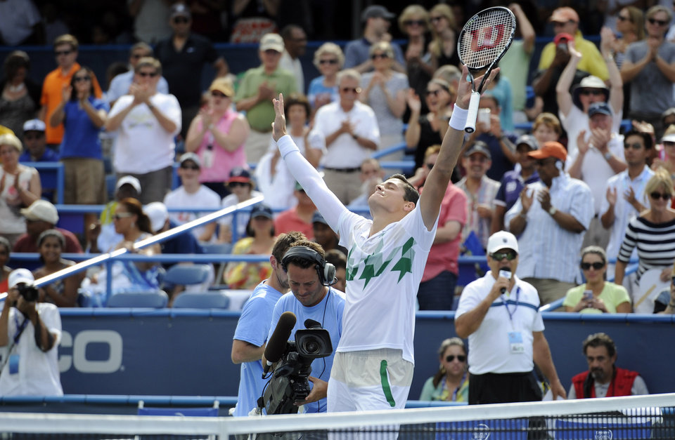 Photo - Milos Raonic, of Canada, celebrates after he beat compatriot Vasek Pospisil in the men's singles final at the Citi Open tennis tournament, Sunday, Aug. 3, 2014, in Washington. Raonic won 6-1, 6-4. (AP Photo/Nick Wass)