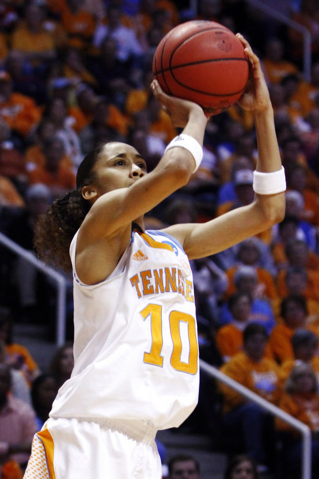 Photo - Tennessee guard Meighan Simmons (10) shoots in the second half of a first-round game in the women's NCAA college basketball tournament against Oral Roberts, Saturday, March 23, 2013, in Knoxville, Tenn. Tennessee won 83-62. (AP Photo/Wade Payne)