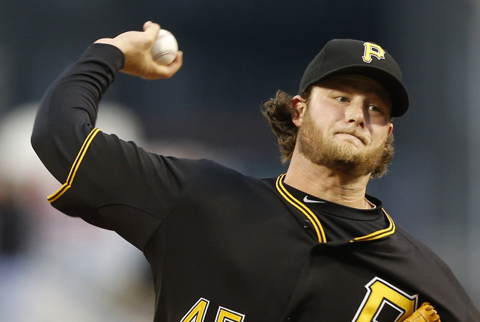 Photo - Pittsburgh Pirates starting pitcher Gerrit Cole (45) throws against the Toronto Blue Jays in the first inning of a baseball game on Friday, May 2, 2014, in Pittsburgh. (AP Photo/Keith Srakocic)