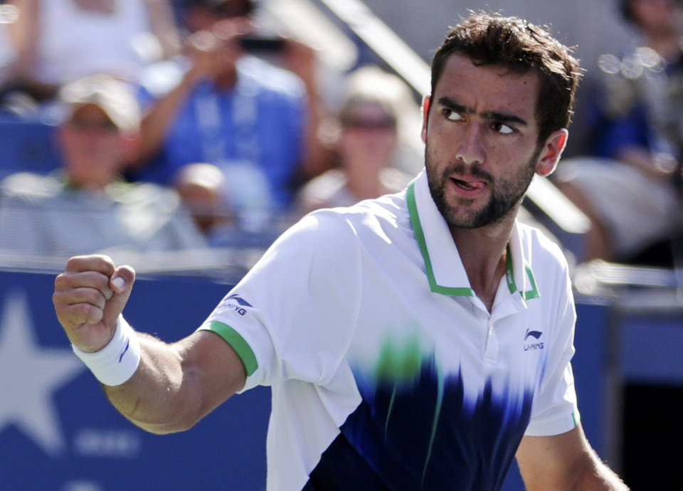 Photo - Marin Cilic, of Croatia, reacts after winning a game against Tomas Berdych, of the Czech Republic, during the quarterfinals of the 2014 U.S. Open tennis tournament, Thursday, Sept. 4, 2014, in New York. (AP Photo/Julio Cortez)