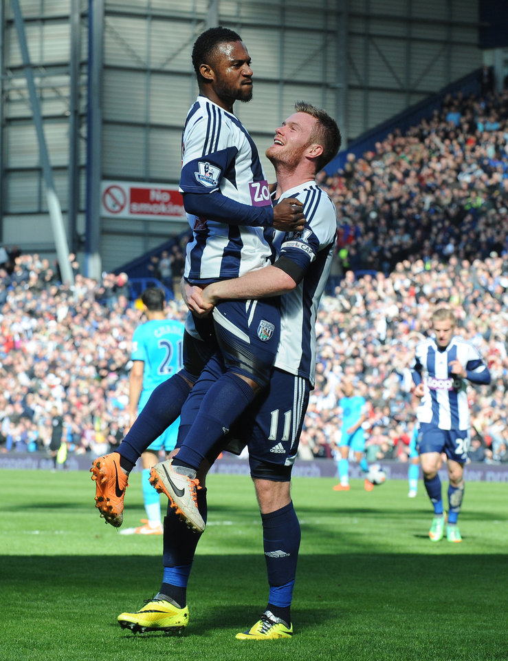 Photo - West Brom's Chris Brunt, right, celebrates with Stephane Sessegnon after he scored against Tottenham during the English Premier League soccer match between West Bromwich Albion and Tottenham Hotspur at The Hawthorns Stadium in West Bromwich, England, Saturday, April 12, 2014.  (AP Photo/Rui Vieira)