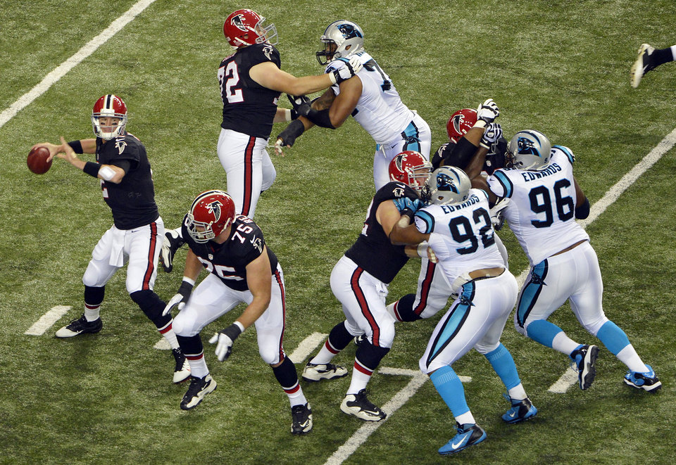 FILE - In this Sept. 30, 2012, filephoto, Atlanta Falcons quarterback Matt Ryan (2) is well protected as he looks for a receiver during the first half of an NFL football game against the Carolina Panthers in Atlanta. Ryan is the NFL's top-rated passer, guiding the Falcons to an unbeaten record and a commanding lead in the NFC South. (AP Photo/Rich Addicks, File)