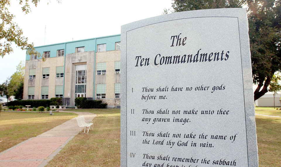 Photo - The Ten Commandments monument is shown in 2004 outside the Haskell County Courthouse in Stigler.  Photo by DAVID CRENSHAW, Tulsa World