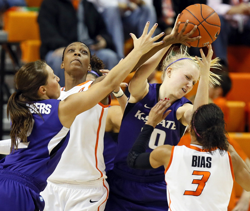 From left, Kansas State's Brittany Chambers (2), Oklahoma State's Toni Young (15), Kansas State's Heidi Brown (10) and Oklahoma State's Tiffany Bias (3) battle for a rebound during an NCAA women's basketball game between Oklahoma State University (OSU) and Kansas State at Gallagher-Iba Arena in Stillwater, Okla., Saturday, Feb. 16, 2013. Photo by Nate Billings, The Oklahoman