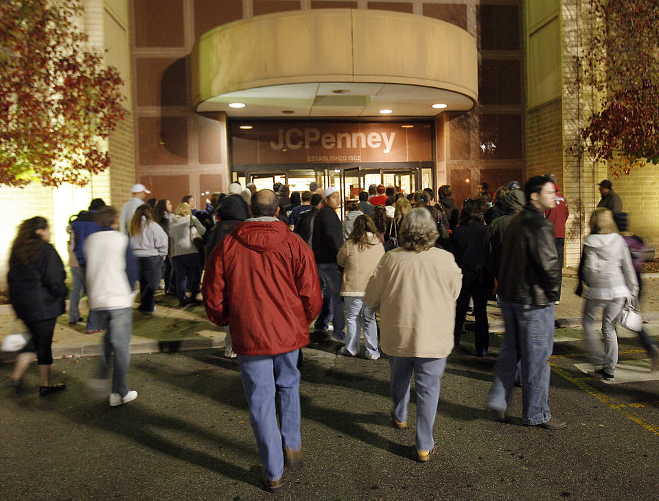 Photo - DAY AFTER THANKSGIVING / HOLIDAY / CHRISTMAS SHOPPING: Early morning shoppers enter J.C. Penney Co. Inc. store at Penn Square Mall at 3:45 a.m. on Black Friday, November 28, 2008. Photo by David McDaniel/The Oklahoman  ORG XMIT: KOD