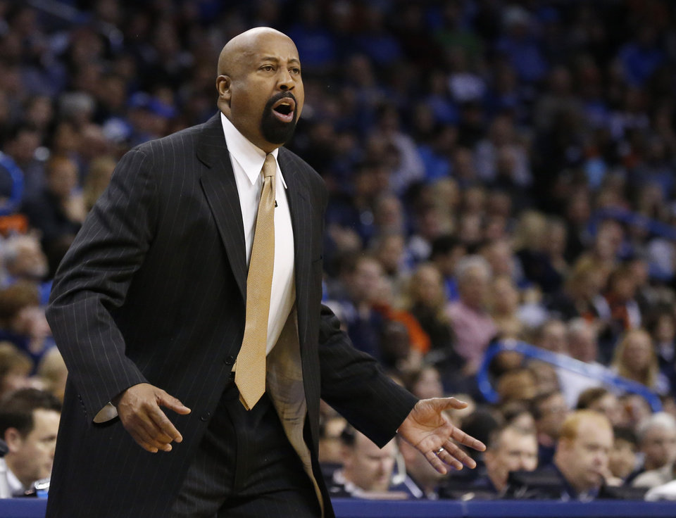 Photo - New York Knicks head coch Mike Woodson shouts in the first quarter of an NBA basketball game against the Oklahoma City Thunder in Oklahoma City, Sunday, Feb. 9, 2014. (AP Photo/Sue Ogrocki)