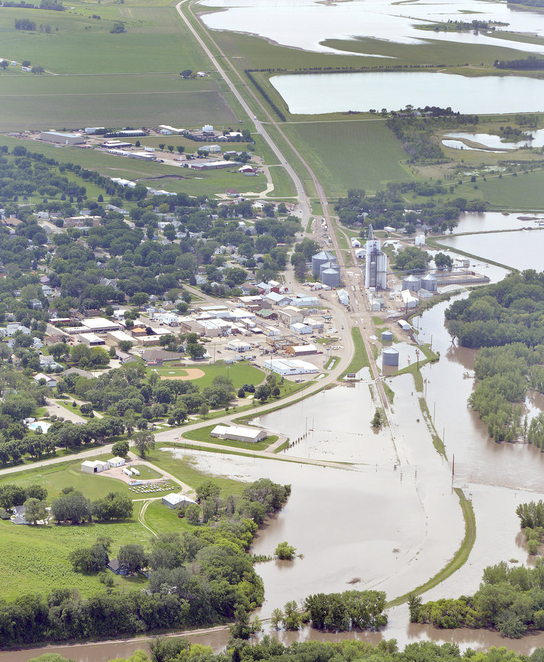 Photo - The flood-swollen Big Sioux River is shown Thursday, June 19, 2014, at Akron, Iowa. Cities along the river were working to battle record flooding from the river. (AP Photo/Sioux City Journal, Tim Hynds)