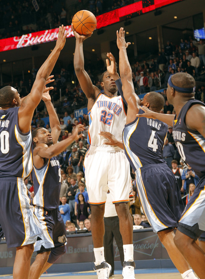 The Thunder's Jeff Green (22) is surrounded by the Memphis defense as he puts up a shot over Sam Young (4) during the NBA basketball game between the Oklahoma City Thunder and the Memphis Grizzlies at the Oklahoma City Arena on Tuesday, Feb. 8, 2011, Oklahoma City, Okla.