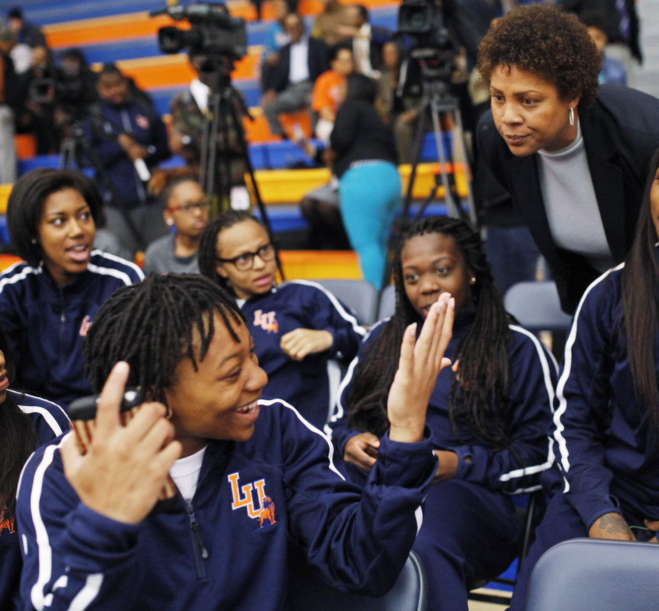 Photo - Women's basketball great Cheryl Miller talks to her team before the beginning of a press conference where she was introduced as the head coach of Langston's women's basketball program on Tuesday, April 29, 2014 Photo by KT King, The Oklahoman