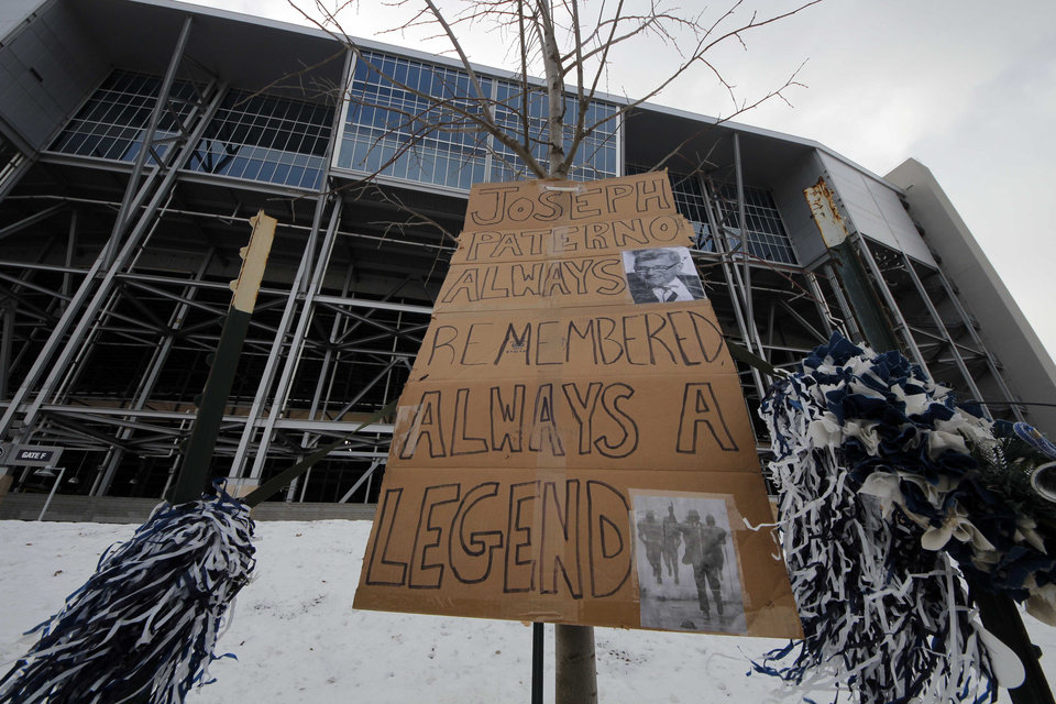 Photo - A sign of support is displayed near the site where a bronze statue of former Penn State head coach Joe Paterno once stood outside Beaver Stadium in State College, Pa., Tuesday, Jan. 22, 2013. Supporters of Paterno are marking the 1-year anniversary of his death with a candlelight vigil Tuesday night.  (AP Photo/Gene J. Puskar)
