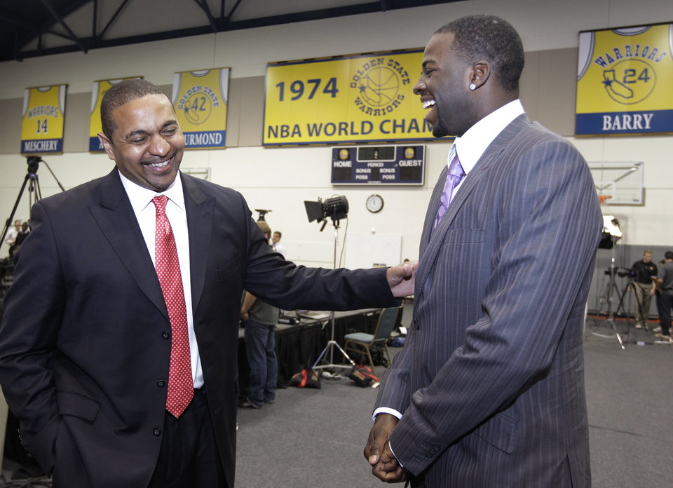 Golden State Warriors third draft pick Draymond Green, right, a forward from Michigan State, smiles with head coach Mark Jackson, left, after a news conference at Warriors headquarters in Oakland, Calif., Monday, July 2, 2012. (AP Photo/Paul Sakuma)