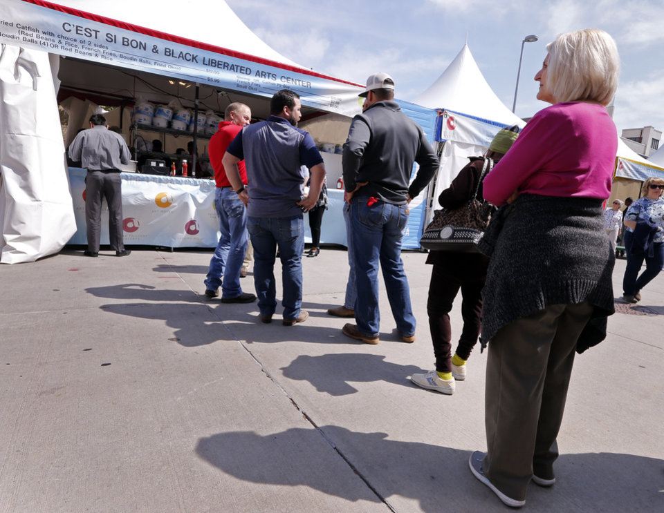 Photo -  A line forms at C'est Si Bon at the Festival of the Arts at OKC's Bicentennial Park on Tuesday in Oklahoma City. [Photo by Steve Sisney, The Oklahoman]
