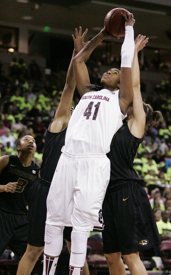 Photo - South Carolina's Alaina Coates (41) drives for the basket as Missouri tries to defend during the first half of their NCAA college basketball game, Sunday Feb. 2, 2014, in Columbia, SC. (AP Photo/Mary Ann Chastain)