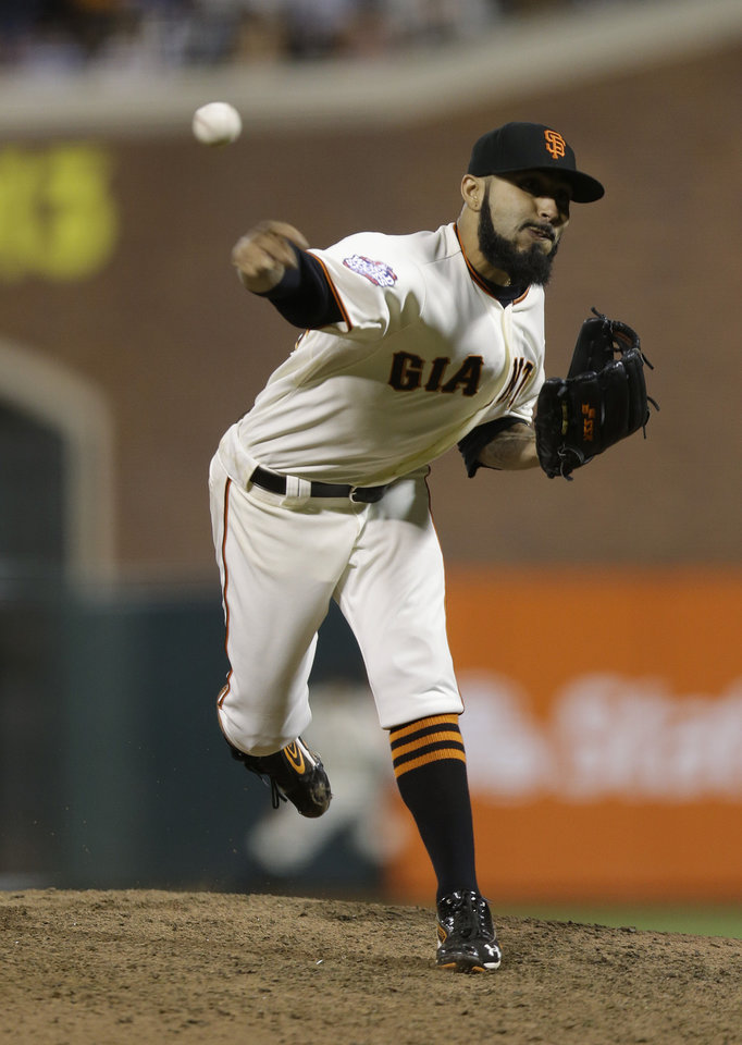 Photo -   San Francisco Giants' Sergio Romo throws during the ninth inning of Game 2 of baseball's World Series against the Detroit Tigers Thursday, Oct. 25, 2012, in San Francisco. (AP Photo/Marcio Jose Sanchez)