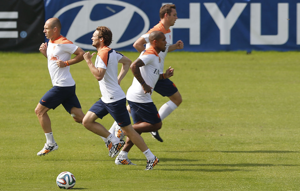 Photo - Seen from left to right, Arjen Robben, Daley Blind, Nigel de Jong, and Stefan de Vrij of the Netherlands train in group separate from the rest of their team in Rio de Janeiro, Brazil, Thursday, June 26, 2014.  Netherlands will play Group A runner-up Mexico in the second round on Sunday in Fortaleza. (AP Photo/Wong Maye-E)