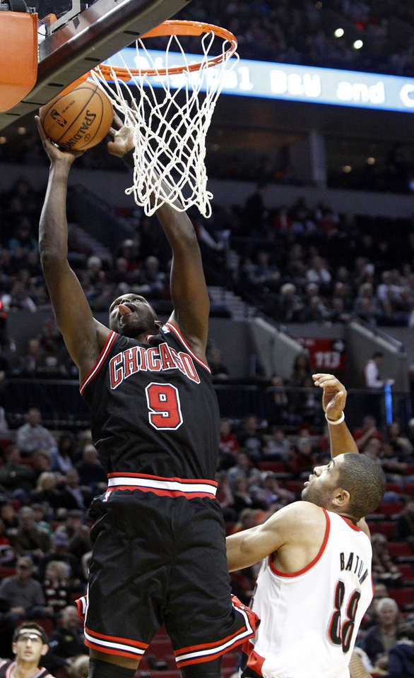 Chicago Bulls forward Luol Deng, left, scores over Portland Trail Blazers forward Nicolas Batum, from France, during the first quarter of their NBA basketball game in Portland, Ore., Sunday, Nov. 18, 2012. (AP Photo/Don Ryan)