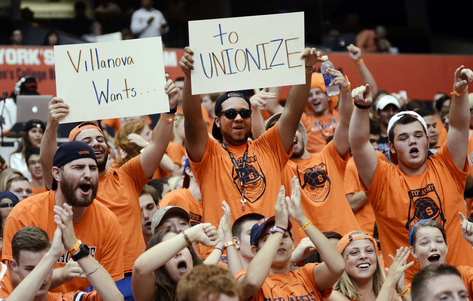 Photo - Syracuse University students show their support for the Syracuse Orange before they take on the Villanova Wildcats at the Carrier Dome in Syracuse, N.Y., Friday, August 29, 2014. (AP Photo/Heather Ainsworth)