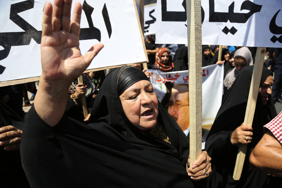 Photo - A supporter of Prime Minister Nouri al-Maliki, chants slogans during a demonstration in Baghdad, Iraq, Wednesday, Aug 13, 2014. Tanks and Humvees were positioned on Baghdad bridges and at major intersections on Wednesday, with security personnel more visible than usual as pro-Maliki demonstrators took to Firdous Square in the capital, pledging their allegiance to him. (AP Photo/Karim Kadim)
