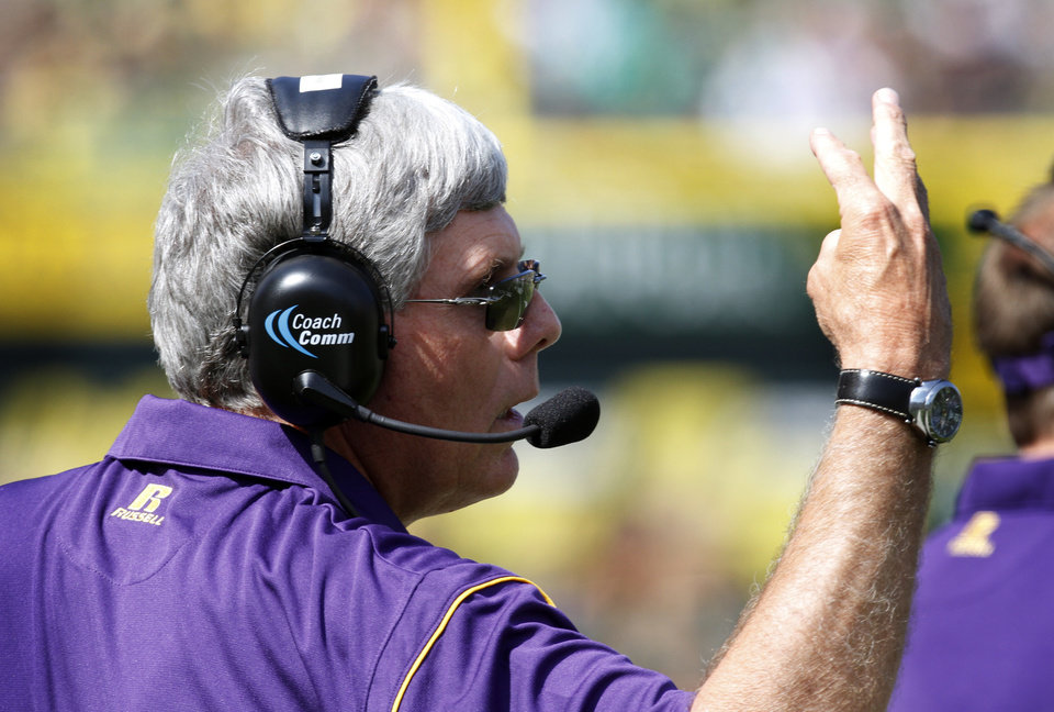 Photo -   Tennessee Tech football coach Watson Brown calls signals from the sideline during the first half of their NCAA college football game against Oregon in Eugene, Ore., Saturday, Sept. 15, 2012. (AP Photo/Don Ryan)