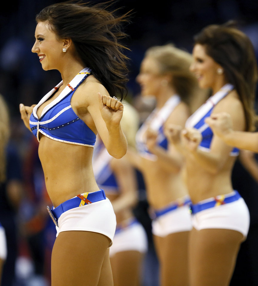 The Thunder Girls dance team performs during an NBA basketball game between the New York Knicks and the Oklahoma City Thunder at Chesapeake Energy Arena in Oklahoma City, Sunday, Feb. 9, 2014. Photo by Nate Billings, The Oklahoman