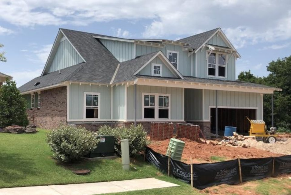 Photo -  A home under construction by McCaleb Homes is shown on Rodkey Mill Circle in Edmond's Town Square addition, developed by Caleb McCaleb. [RICHARD MIZE/THE OKLAHOMAN]