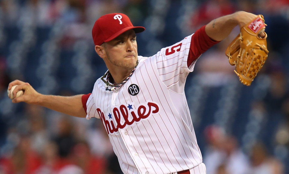 Photo - Philadelphia Phillies pitcher David Buchanan throws in the first inning of a baseball game with the St Louis Cardinals, Saturday, Aug. 23, 2014, in Philadelphia. (AP Photo/Laurence Kesterson)