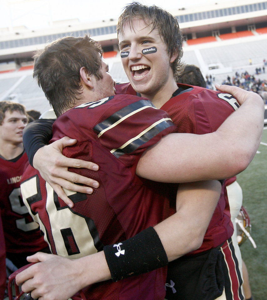 Lincoln Christian's Cale Grauer, right, celebrates with Cameron Johnson after winning the Class 2A high school football state championship game between Kingfisher and Lincoln Christian at Boone Pickens Stadium in Stillwater, Okla., Saturday, December 12, 2009.  Photo by Bryan Terry, The Oklahoman