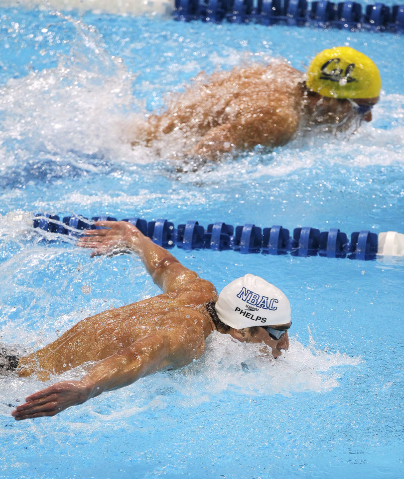 Photo -   Michael Phelps and Tom Shields, top, swim in the men's 200-meter butterfly final at the U.S. Olympic swimming trials, Sunday, July 1, 2012, in Omaha, Neb. Phelps won the final. (AP Photo/Nati Harnik)