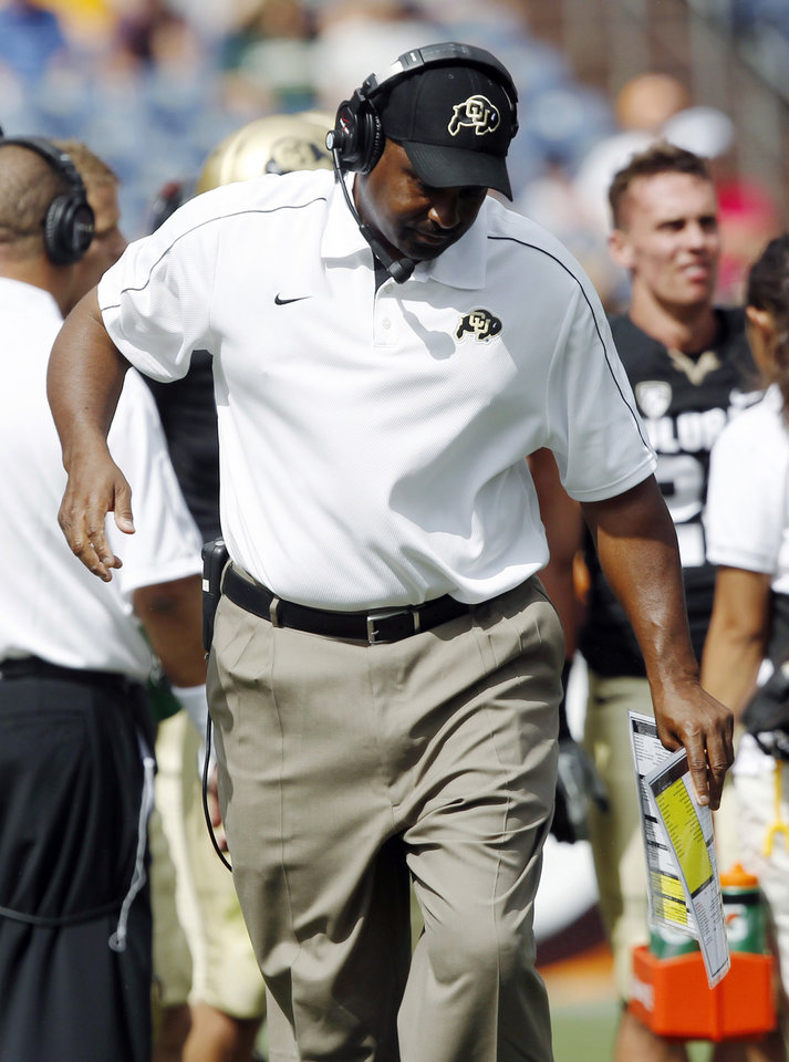 Photo -   Colorado head coach Jon Embree reacts to a call in the second quarter of an NCAA college football game against Colorado State in Denver on Saturday, Sept. 1, 2012. (AP Photo/David Zalubowski)