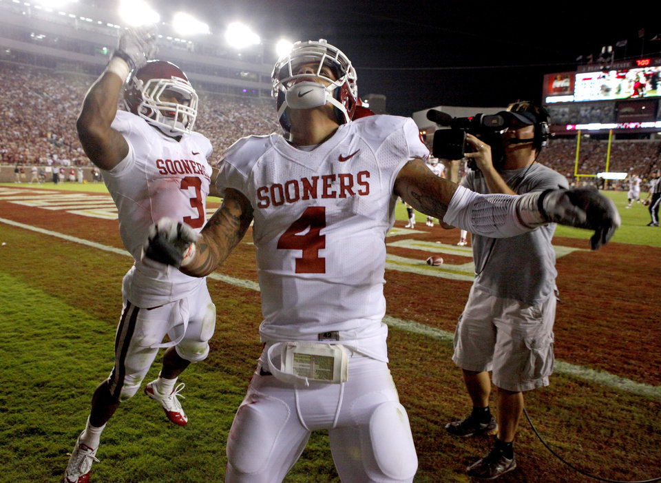 Oklahoma's Kenny Stills (4) celebrates with Brennan Clay (3) after Stills scores a touchdown during a college football game between the University of Oklahoma (OU) and Florida State (FSU) at Doak Campbell Stadium in Tallahassee, Fla., Saturday, Sept. 17, 2011. Oklahoma won 23-13. Photo by Bryan Terry, The Oklahoman