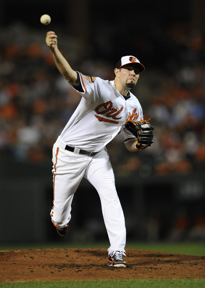 Photo -   Baltimore Orioles starting pitcher Jason Hammel throws to a New York Yankees batter during the second inning of a baseball game, Thursday, Sept. 6, 2012, in Baltimore. (AP Photo/Nick Wass)