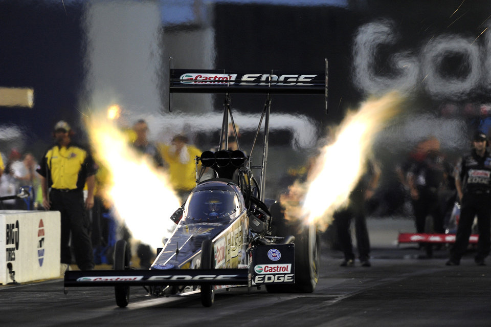 Photo - In this photo provided by NHRA, Top Fuel driver Brittany Force drives to the provisional qualifying lead Friday, July 25, 2014, at the NHRA Sonoma Nationals drag races in Sonoma, Calif. (AP Photo/NHRA, Marc Gewertz)