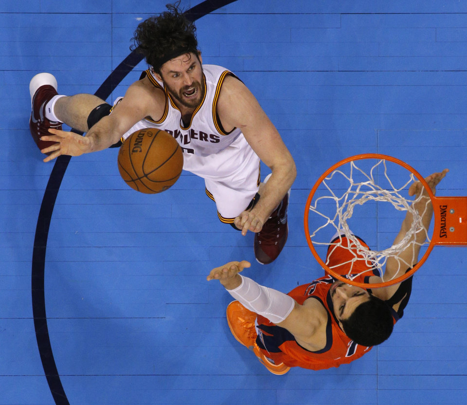 Photo - Cleveland's Kevin Love (0) puts up a shot over Oklahoma City's Enes Kanter (11) during an NBA basketball game between the Oklahoma City Thunder and the Cleveland Cavaliers at Chesapeake Energy Arena in Oklahoma City, Sunday, Feb. 21, 2016. Oklahoma City lost 115-92.  Photo by Bryan Terry, The Oklahoman
