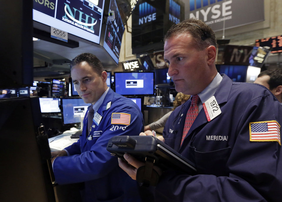 Photo - Specialist Jason Hardzewicz, left, and trader Jonathan Corpina work on the floor of the New York Stock Exchange, Monday, Aug. 4, 2014. U.S. stocks are opening mostly higher as the market recovers from a two-day slide last week. (AP Photo/Richard Drew)