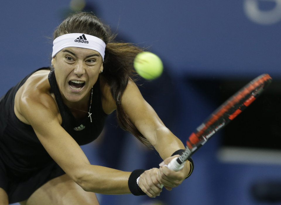 Photo - Sorana Cirstea, of Romania, returns a shot to Eugenie Bouchard, of Canada, during the second round of the 2014 U.S. Open tennis tournament Thursday, Aug. 28, 2014, in New York. (AP Photo/Darron Cummings)