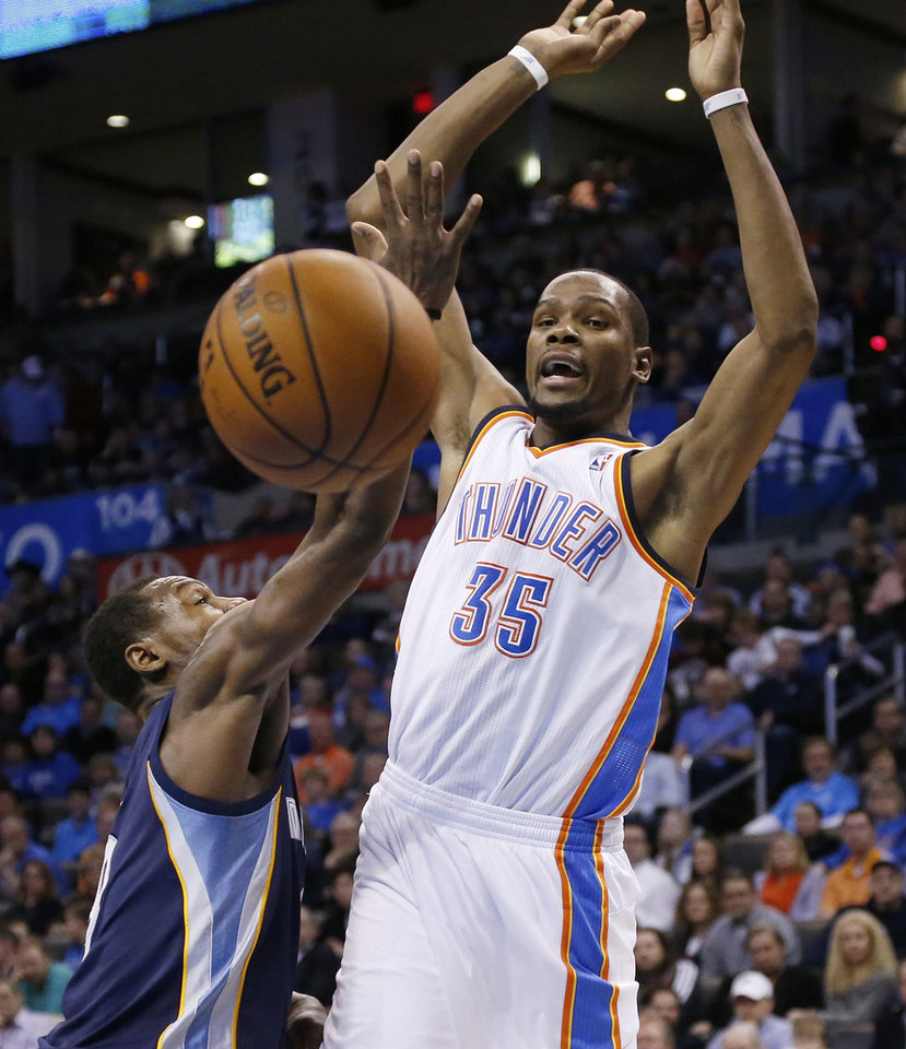 Photo - Oklahoma City Thunder forward Kevin Durant (35) loses the ball as he is fouled by Memphis Grizzlies guard Tony Allen (9) during the fourth quarter of an NBA basketball game in Oklahoma City, Friday, Feb. 28, 2014. Oklahoma City won 113-107. (AP Photo/Sue Ogrocki)