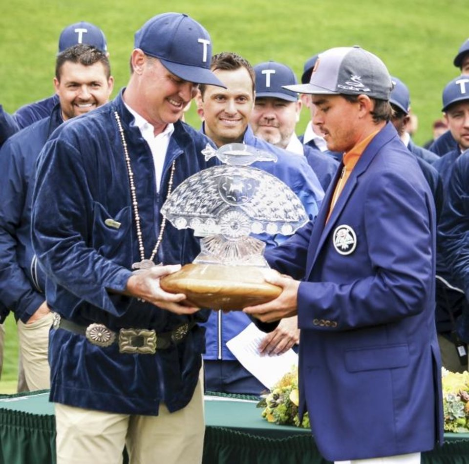 Photo -  One of the last duties Oklahoma native Chance Cozby, left, performed as tournament director of the Waste Management Phoenix Open was presenting the trophy to Rickie Fowler. Even though Cozby went Oklahoma and Fowler went to Oklahoma State, Cozby was thrilled about Fowler's win on Sunday. [PHOTO COURTESY OF THE WASTE MANAGEMENT PHOENIX OPEN]
