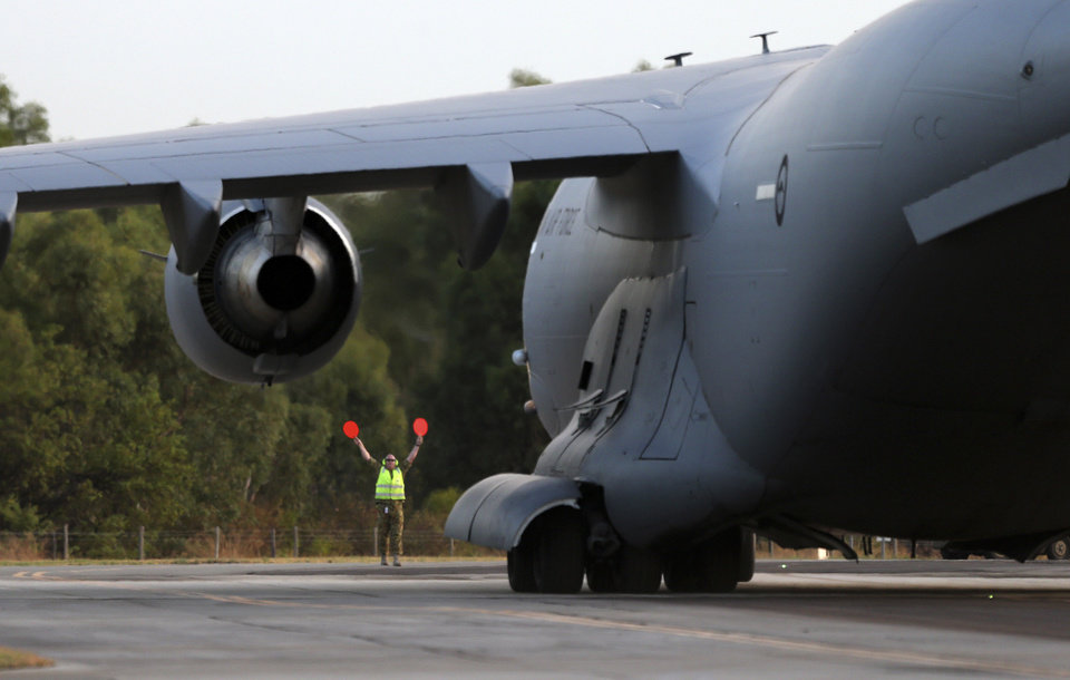 Photo - Royal Australia Air Force C-17 lands at RAAF Base Pearce to deliver a Sea Hawk helicopter to help with the search for the missing Malaysia Airlines Flight MH370, in Perth, Australia, Friday, March 28, 2014. Australian officials moved the search area for the lost Malaysian jetliner 1,100 kilometers (680 miles) to the northeast Friday, following a new analysis of radar data, and a plane quickly found objects that a ship set out to investigate. (AP Photo/Rob Griffith)