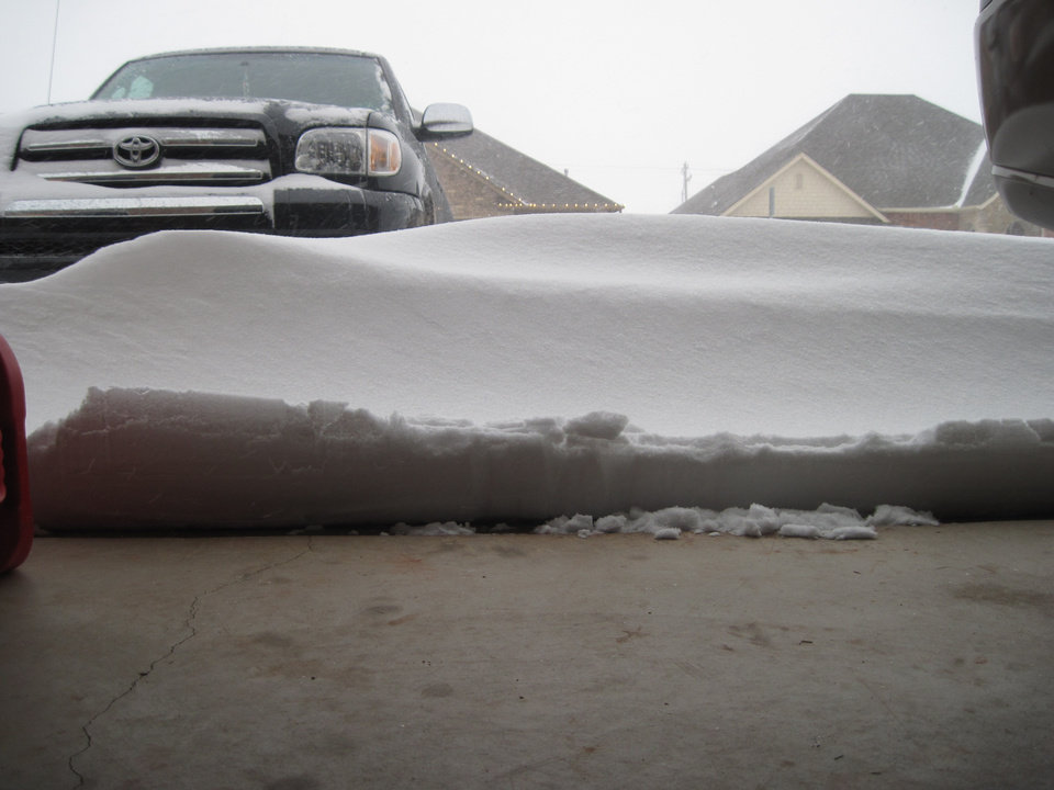 Snow piled up against garage door in Moore, OK.  Submitted by Justin Greenfield.