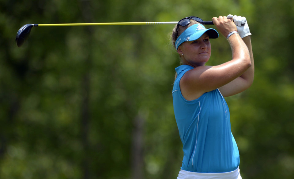 Photo - Anna Nordqvist, of Sweden, hits her tee shot on the fourth hole in the final round of the Airbus LPGA Classic golf tournament at Magnolia Grove on Sunday, May 25, 2014, in Mobile, Ala. (AP Photo/G.M. Andrews)