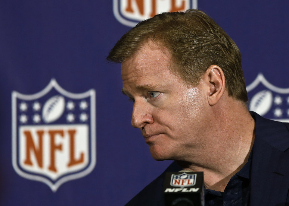 Photo - NFL Commissioner Roger Goodell listens to a reporter's question during a news conference at the annual NFL football meetings at the Arizona Biltmore, Wednesday, March 20, 2013, in Phoenix. (AP Photo/Ross D. Franklin)