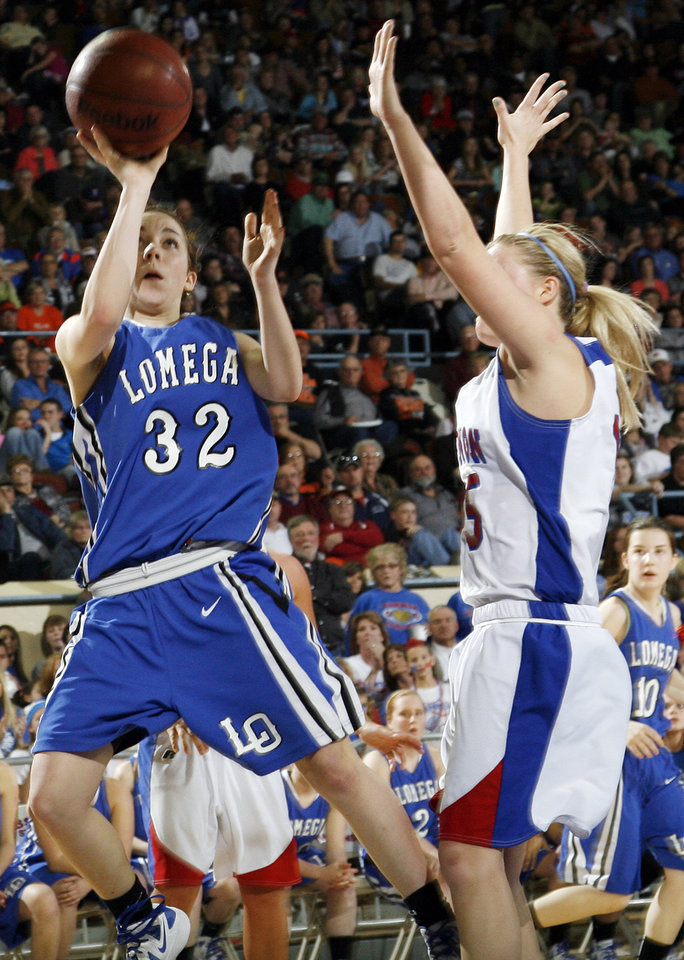 Photo - Lomega's Taylor Mendell (32) shoots against Hammon's Kori Barrios (15) during the Class B girls state championship high school basketball game between Hammon and Lomega at State Fair Arena in Oklahoma City, Saturday, March 3, 2012. Lomega won, 49-44. Photo by Nate Billings, The Oklahoman