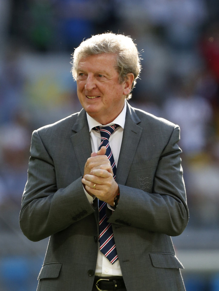 Photo - England's manager Roy Hodgson rubs his nada together after the group D World Cup soccer match between Costa Rica and England at the Mineirao Stadium in Belo Horizonte, Brazil, Tuesday, June 24, 2014.  The match ended in a 0-0 draw. (AP Photo/Jon Super)