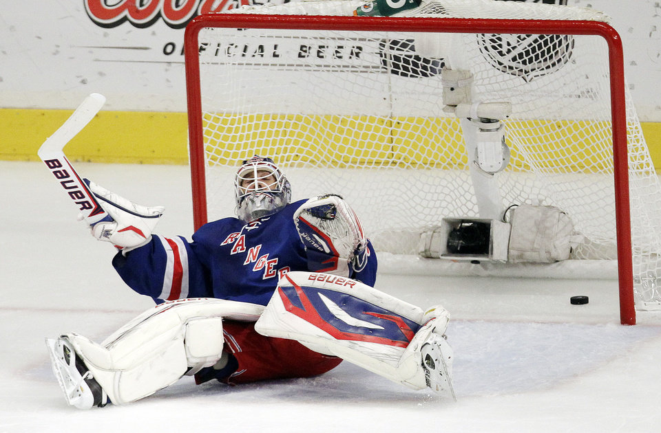 Photo -   A shot by New Jersey Devils' Travis Zajac enters the net behind New York Rangers goalie Henrik Lundqvist, of Sweden, during the first period of Game 5 of an NHL hockey Stanley Cup Eastern Conference final playoff series, Wednesday, May 23, 2012, in New York. (AP Photo/Julio Cortez)