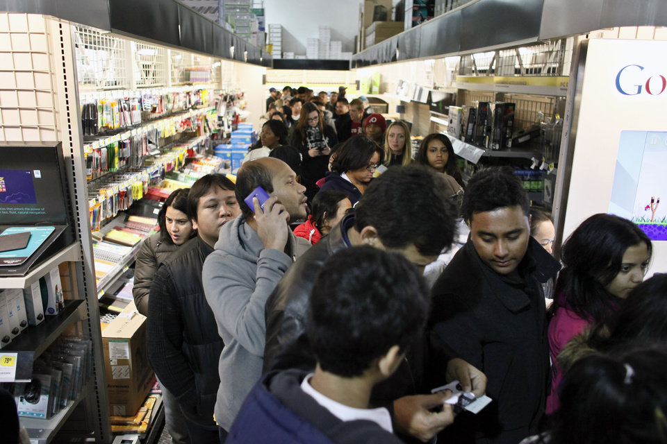 Photo -   Customers wait in line in the computer department to shop for Black Friday discounts at a Best Buy store, Friday Nov 23, 2012, in Northeast Philadelphia. (AP Photo/ Joseph Kaczmarek)